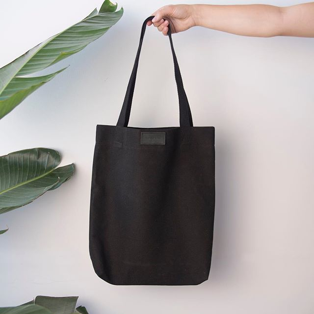 We finally have a tote bag in our favourite colour! Made with a sturdy cotton and black leather patch, available soon.