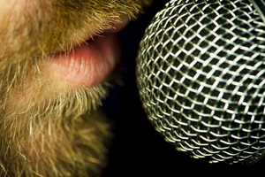 Close up of man speaking into microphone