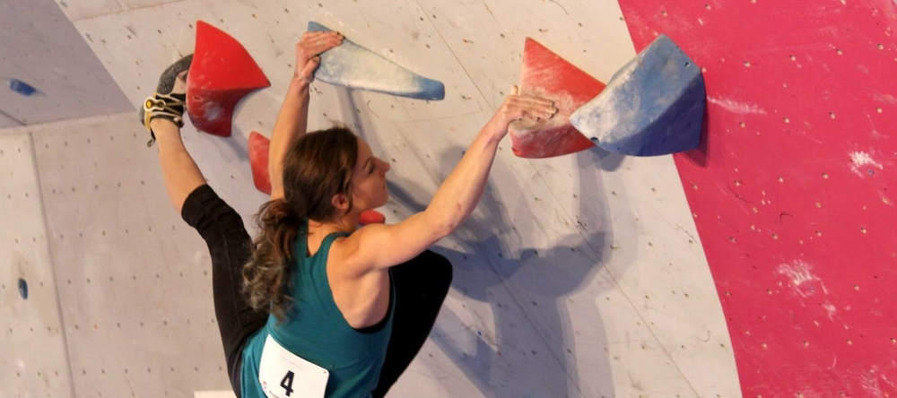 Climbfit instructor Chauncey Carroll crushing a boulder at Bouldering Nationals.