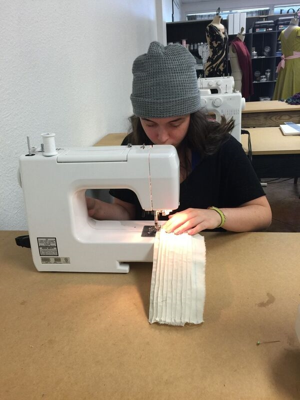 Katherine working hard on her pleats.