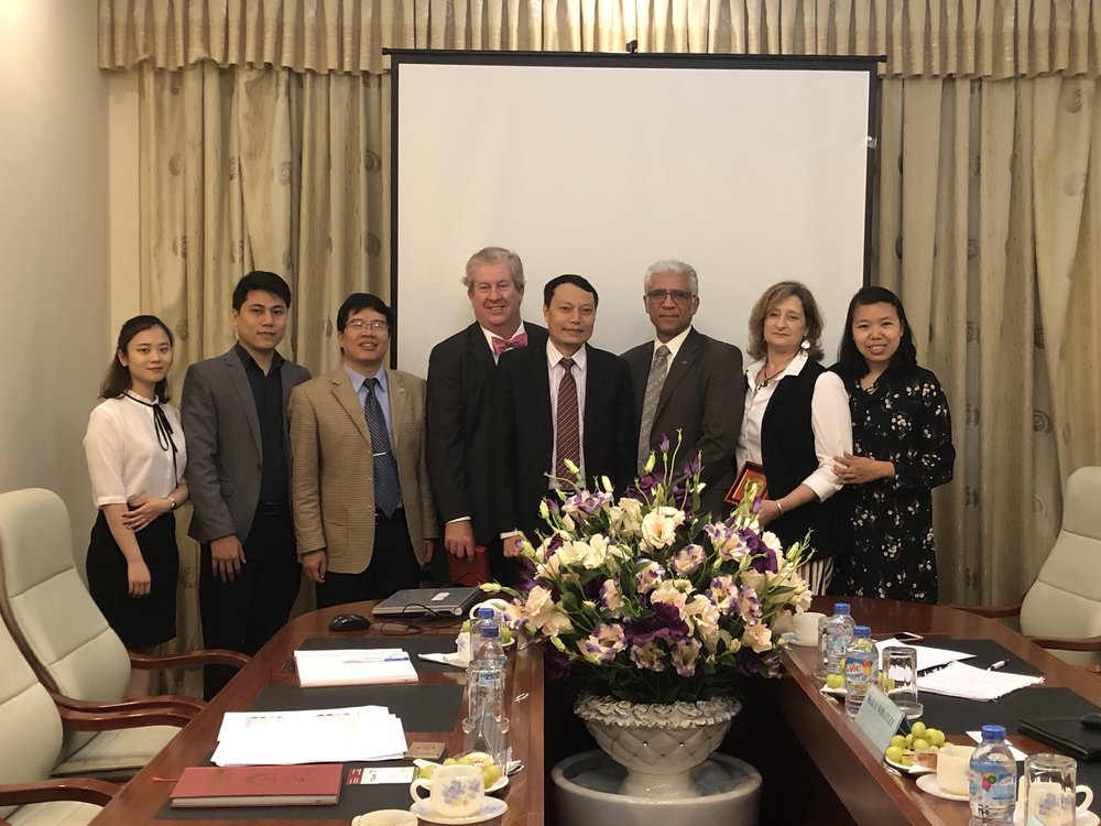 Ray, Kristin, Arun, and our translator Thanh meet with Director Tran, Deputy Director Trinh and their team at VISTEC
