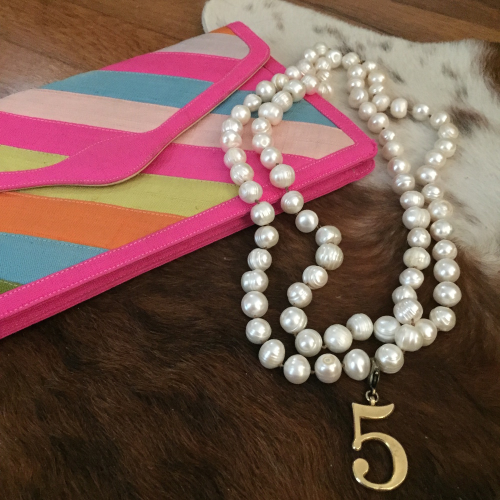 I love pearls, vintages clutches, and the number 5!