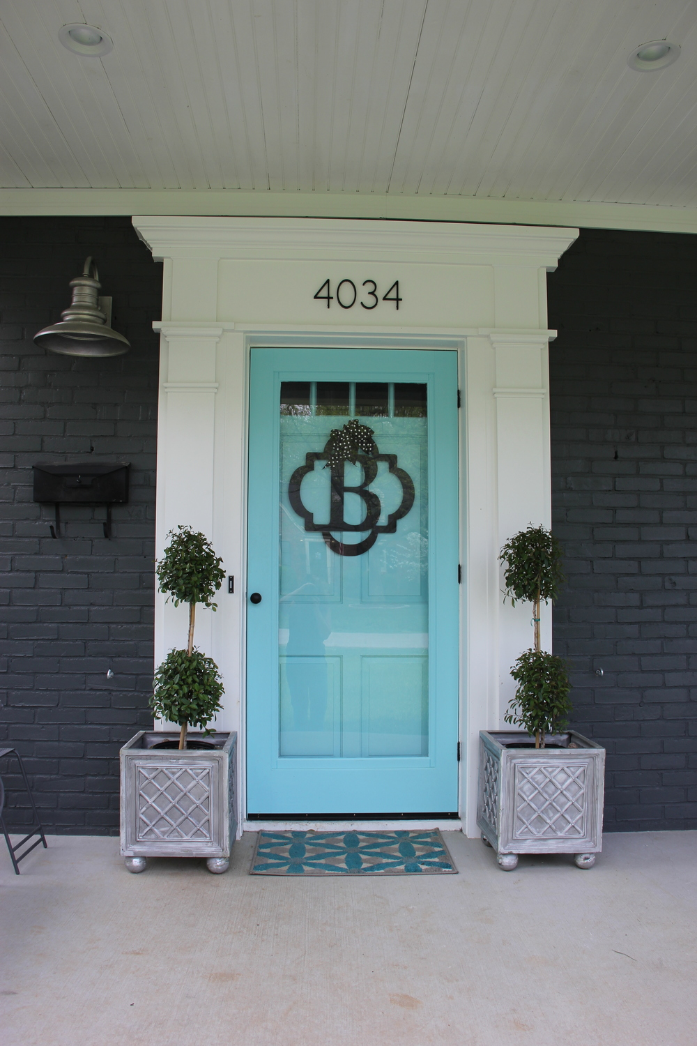 After: Oversized Molding Frames The New Turquoise Door. A Wooden Storm Door,  Painted