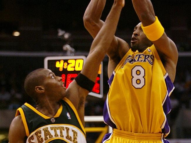Mason gets a hand up in Kobe Bryant's face.Source:AP