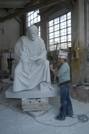 Sarah Hempel Irani working on a marble sculpture of St. Joseph in Pietrasanta.