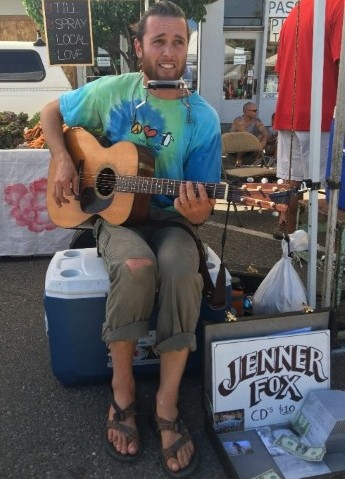 Pictured above is an honest American, chasing the dream, almost making enough at a Saturday market to buy new pair of pants. But more importantly he was able to trade a song for a really big homegrown tomato.