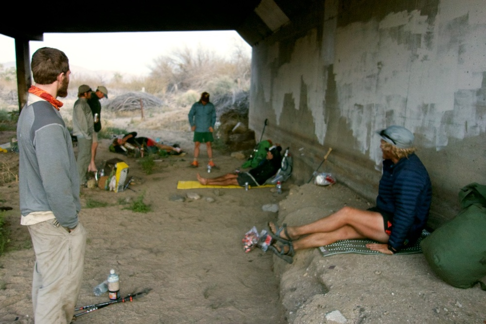 "Thru-hikers affectionately referred to as ""hiker trash"" living the dirt bag lifestyle under the bridge at Scissors Crossing, CA."