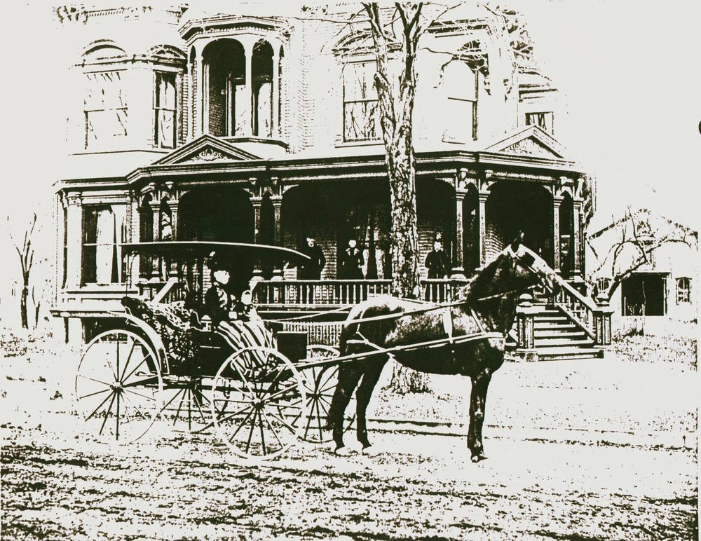 Mrs. Burritt on Horse in Front of House.jpg