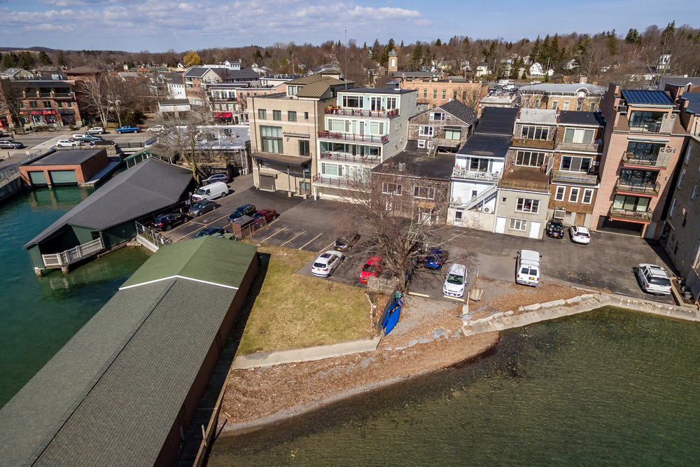 This lakefront building offers 2 retail storefronts, 2 apartments, beautiful views of Skaneateles Lake, and the largest lakefront lawn within the downtown district.