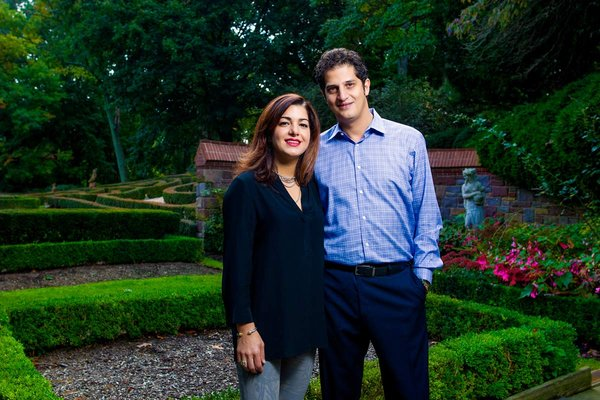 Tahamtan Ahmadi and Parisa Abdollahi in their backyard sculpted garden in Rydal, Pennsylvania. (JEFF FUSCO / For the Philadelphia Inquirer)