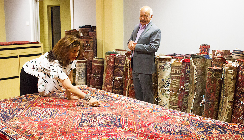Parisa points out asymmetrical details in a rug. | Photo by Lauren McGrath for phillymag.com.