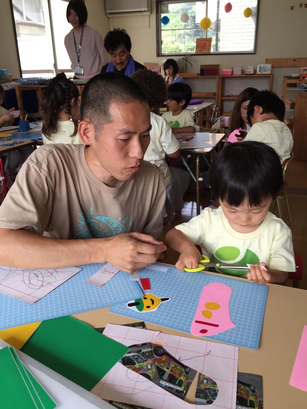 Mr. Monji assisting a Ladybug student.