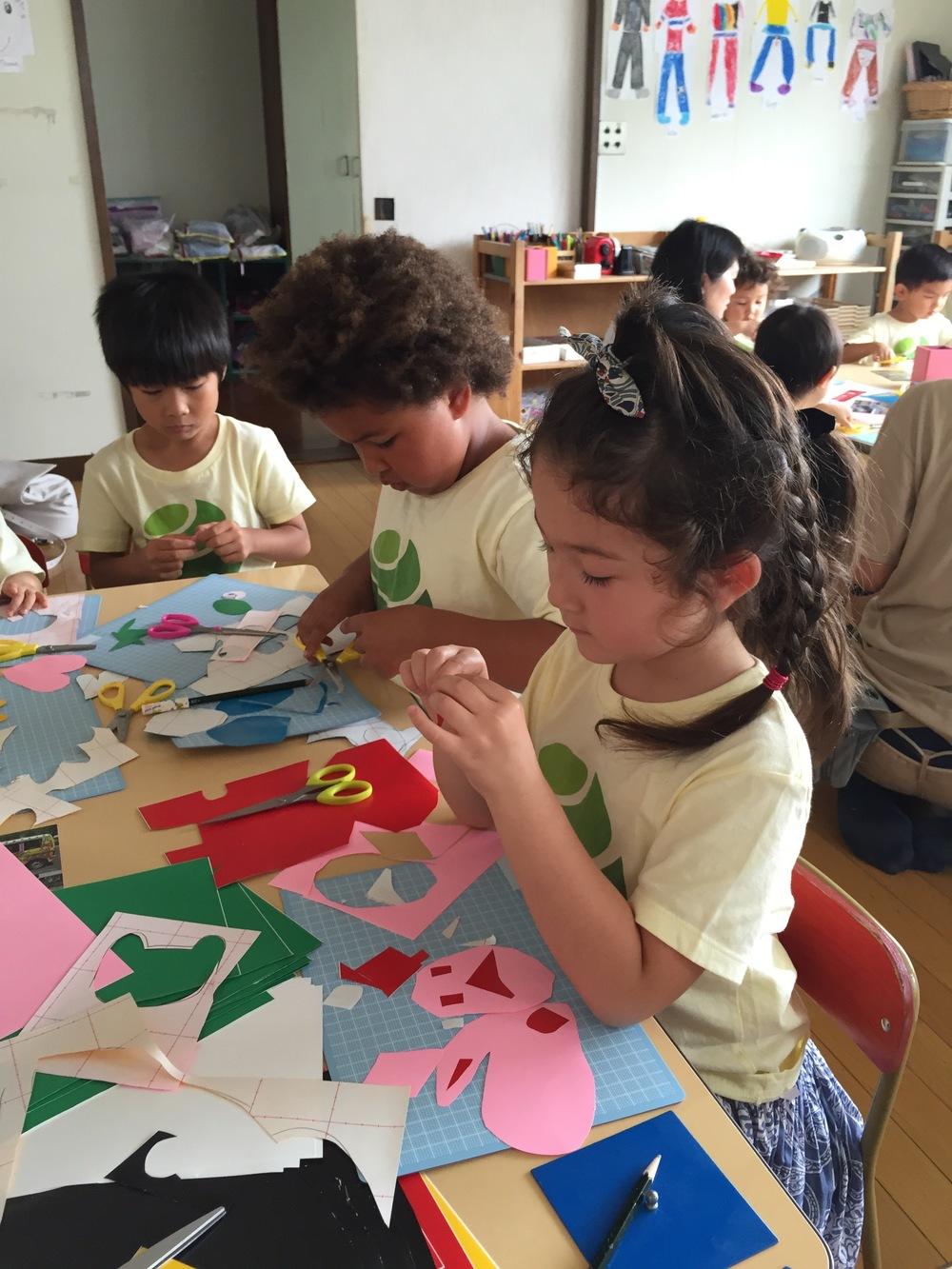 Following Mr. Rocco's instruction, children from the Bluebird class start cutting.