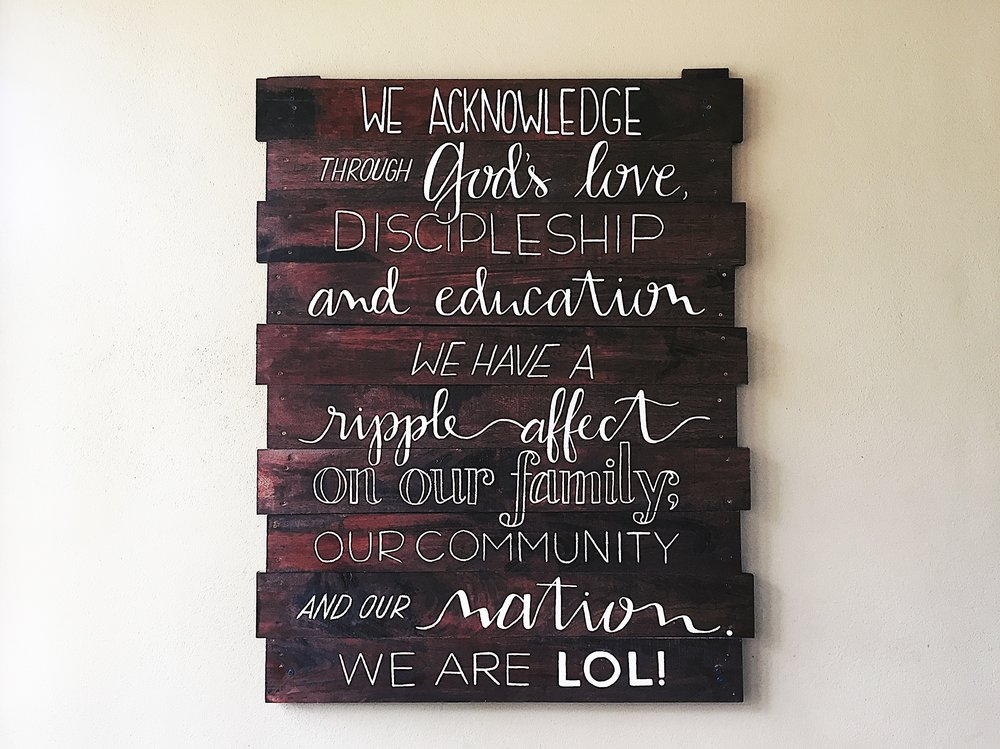 Hand painted mission statement for L.O.L. Children's Home in Southern Belize.