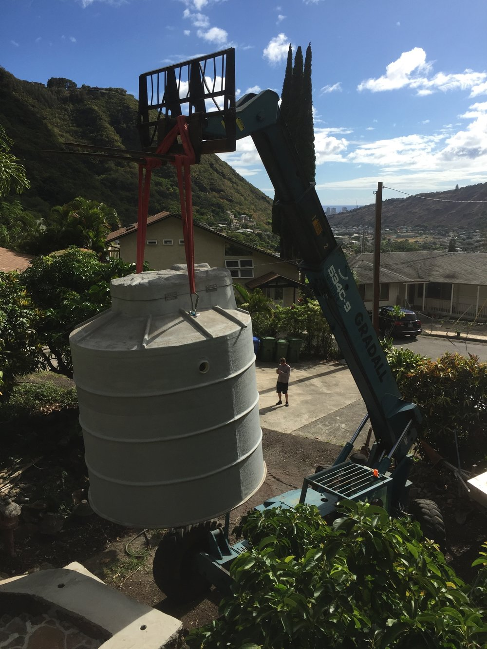 Above: Aerobic Treatment Unit being hoisted into place with a Gradall. Net-zero wastewater is happening right here, right now.