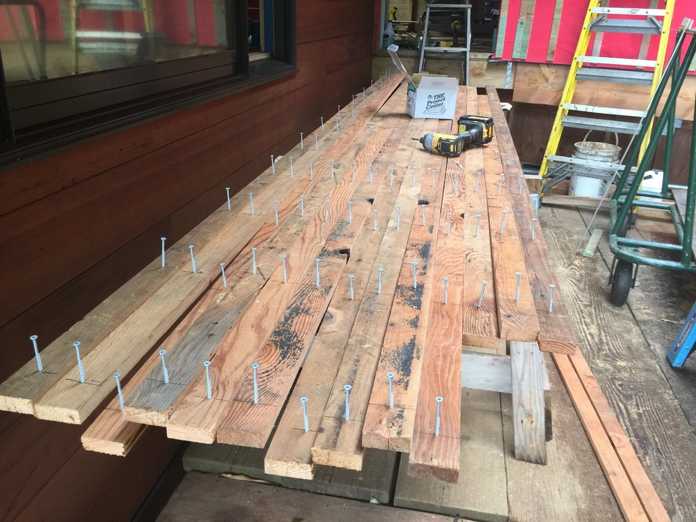 Reclaimed doug fir shiplap deconstruction from single wall homes was repurposed to make elevated battens for the building's roof assembly.