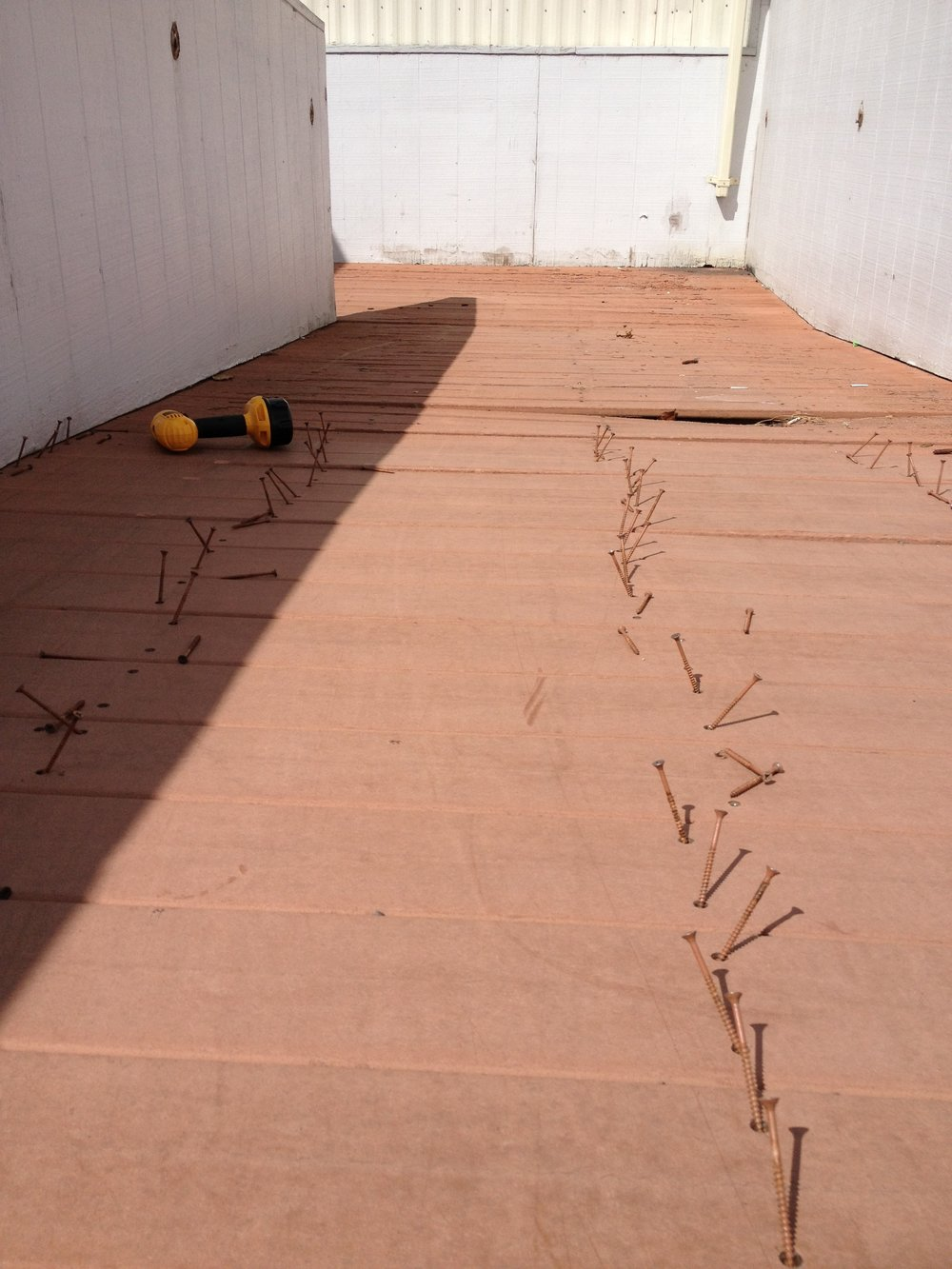 Composite decking was removed from a Delta Airlines maintenance facility at Honolulu International Airport.  The decking boards were flipped over and reused to compose new decks for Haleola'ili'ainapono.