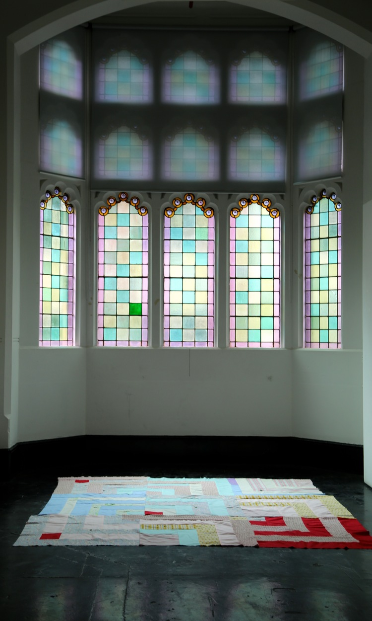 Light Spill, 2014, installation, stained glass windows, patchwork textiles, 4 leafed clovers, dimensions variable