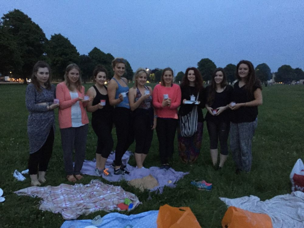 A picture from our yoga social in June with our Kayas holding their scented candle gifts to take home...