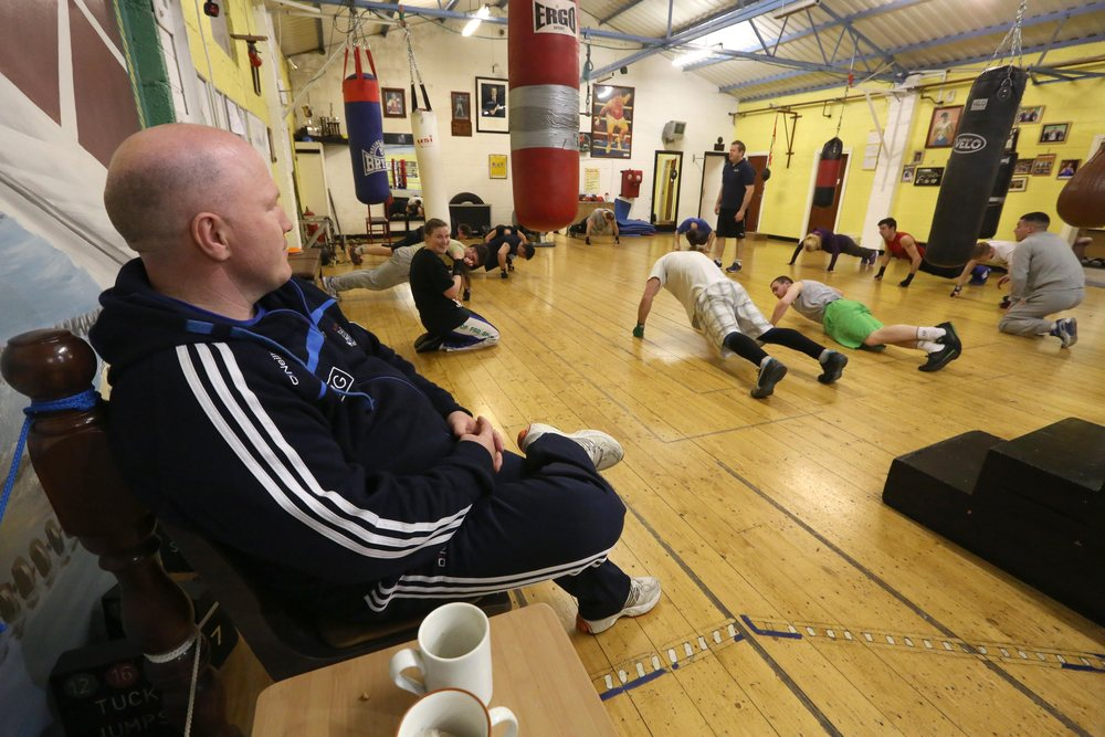 Olympic champion boxer Michael Carruth watching boxers train at Drimnagh Boxing club