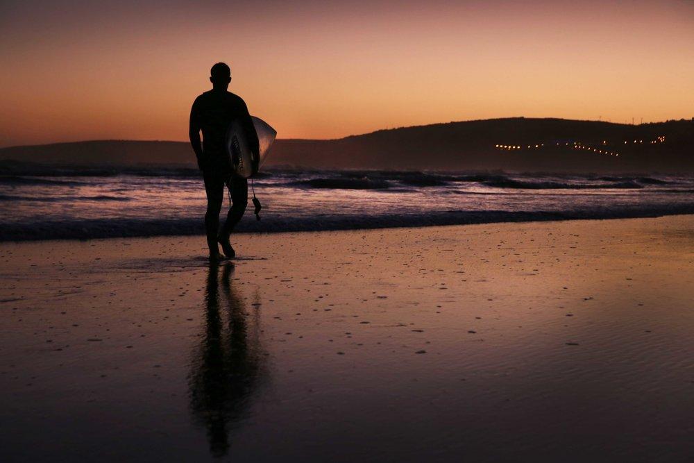 A surfer on Inchydoney Beach in Co Cork