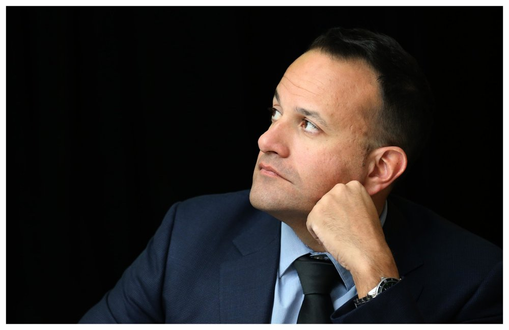 Taoiseach Leo Varadkar listens to speeches at an event.