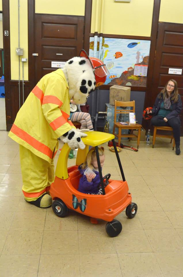 Sparky the Fire Dog visits WSPS on opening day at its new location