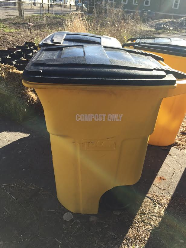 New yellow compost bins located at WBNA and at 20 Almy Street provided by The Compost Plant