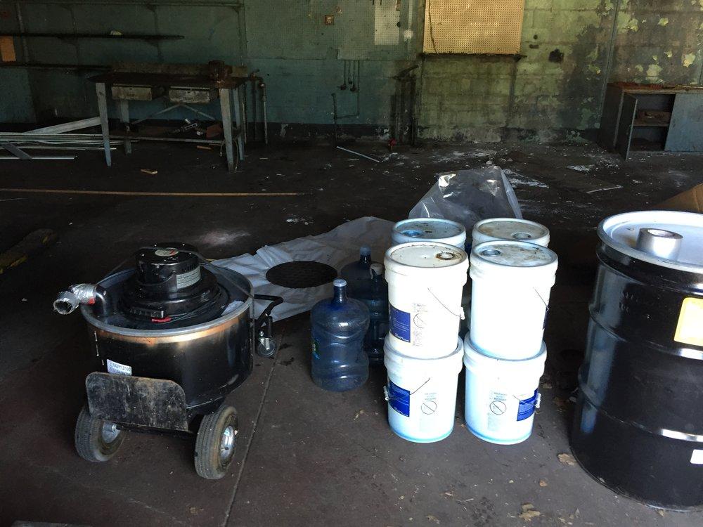 Asbestos removal process before building's demolition, October 2016