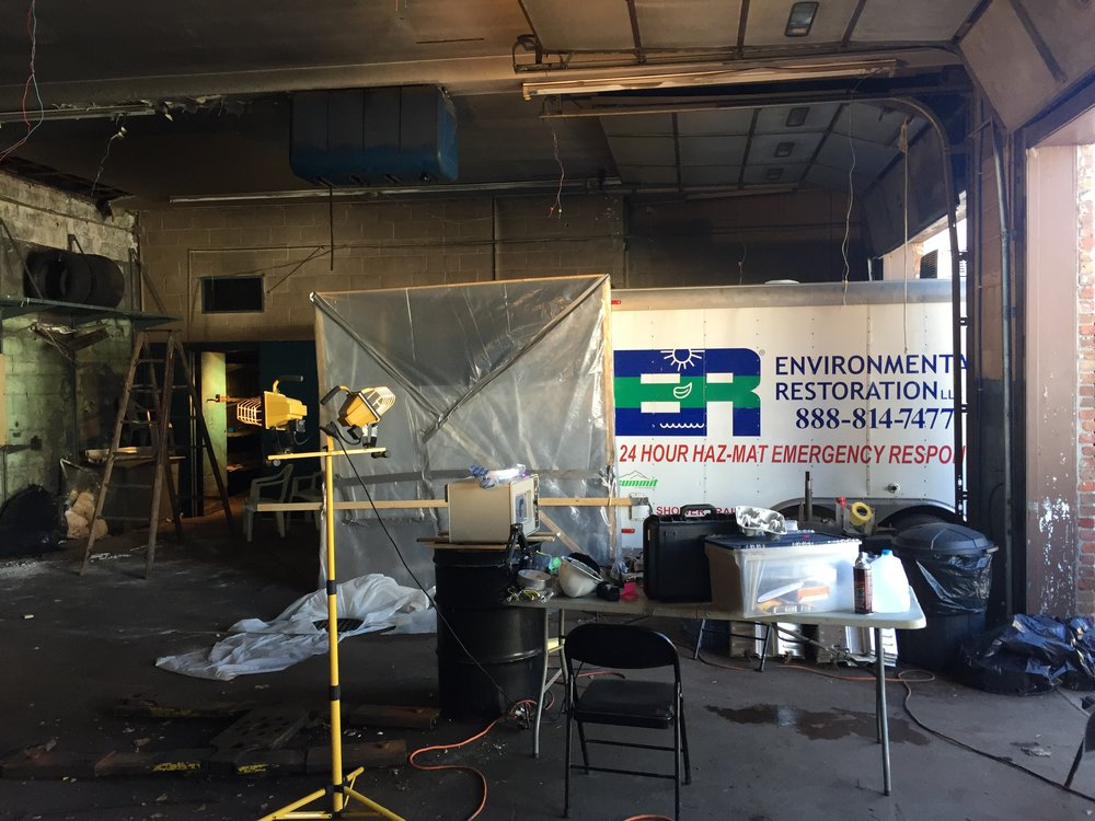 Asbestos removal process before building's demolition, October 2016