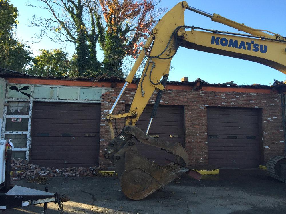 Removal of brick facade reveals original plate-glass and/or aluminum panel framing