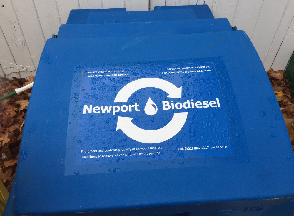 Blue vegetable oil recycling barrel located at WBNA Headquarters, 1560 Westminster.