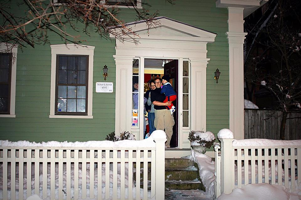 Neighbors on Willow Street come to the door to accept a gift of song (2008)  Photo Credit: Elaine Collins