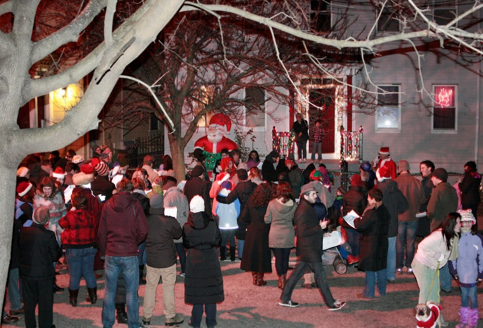 Caroling to a family on Sycamore street (2010)  Photo Credit: Elaine Collins