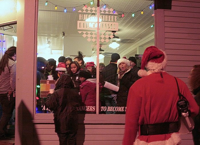 "For years, Hudson Street Deli – ""A place for strangers to become neighbors"" – was a welcoming midpoint warm-up spot for chilly carolers (2011)  Photo Credit: Elaine Collins"