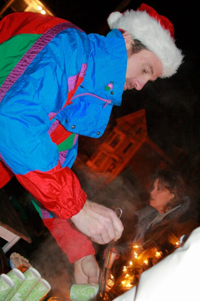 Neighbor Yarrow Thorne serves up traditional Mexican Ponche Navidad, generously donated by Maria Meza of El Rancho Grande (2012)  Photo Credit: Elaine Collins