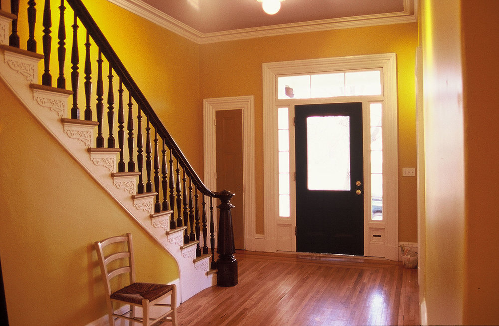Front entry and hall (side light and transom windows restored), 2003  Photo credit: Clark Schoettle, Providence Revolving Fund