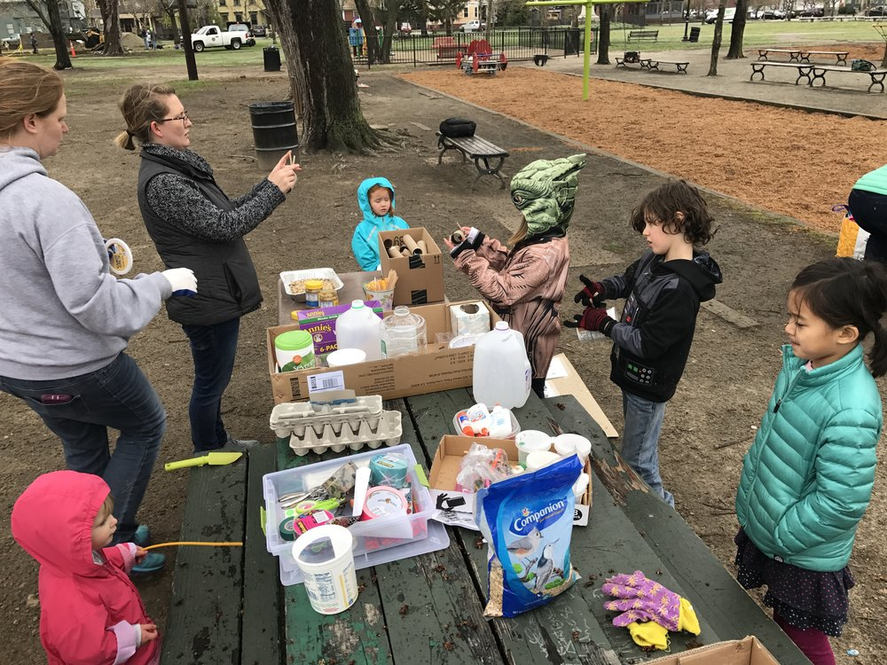 Kids make bird feeders at the Cleanup KidsZone in Dexter Training Ground Photo credit: Caleb Borchers