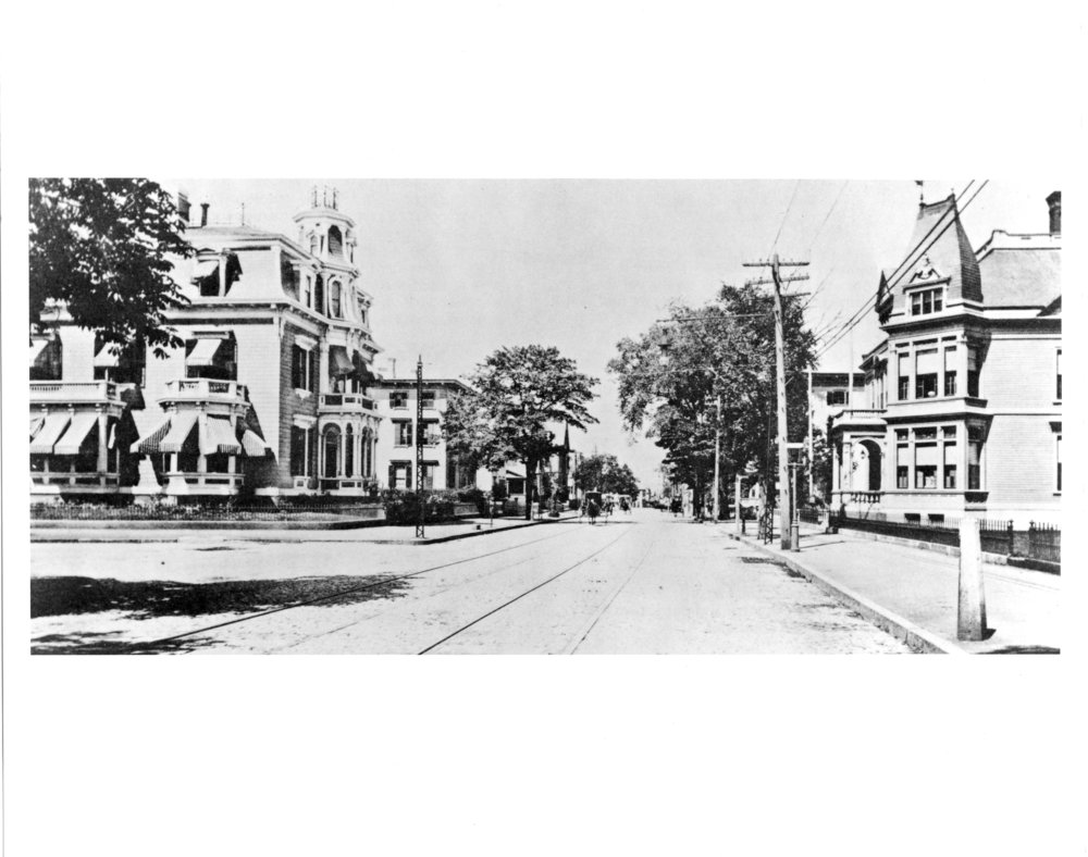 Westminster Street, West End, circa 1900. The first streetcar line was constructed in 1865 on Westminster Street from downtown to Olneyville. Tracks can be seen in this photo.