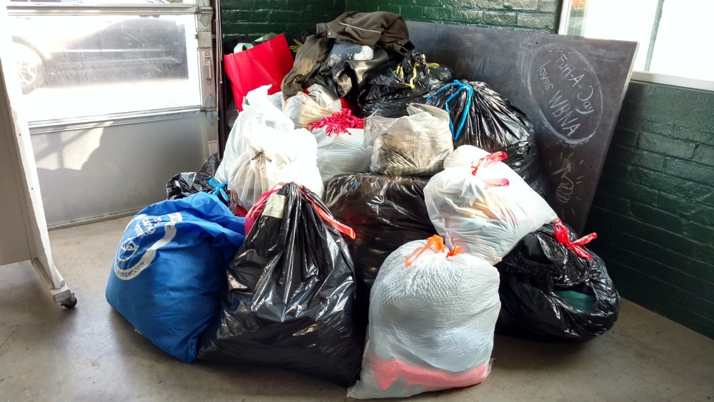 Nearly 25 full trash bags collected of coats, gloves, hats and scarves