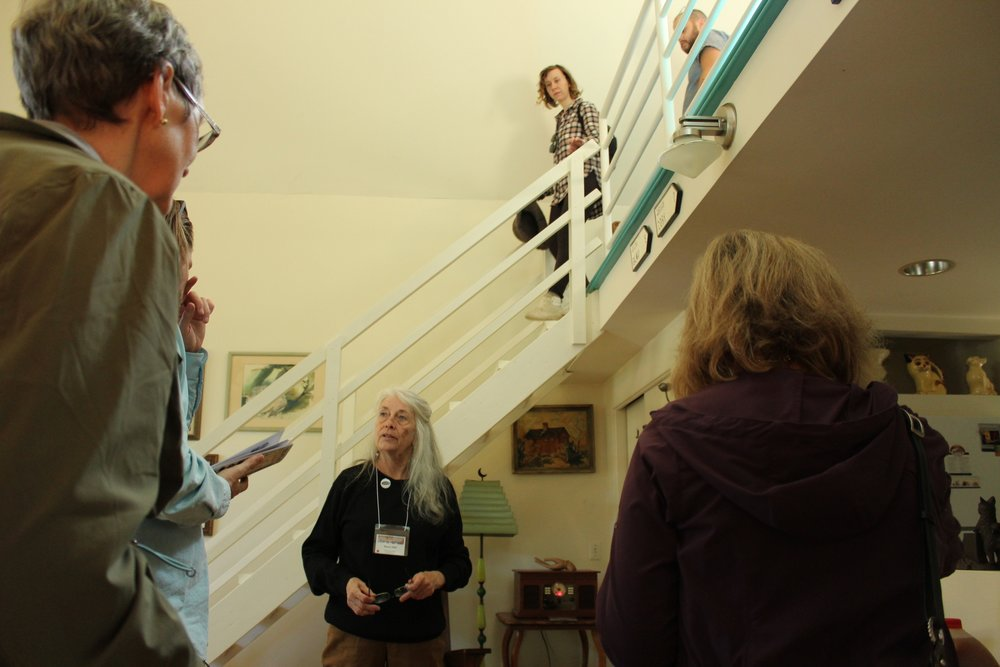 Artist and homeowner Nancy Hart talks with tour goers Photo by Jessica Jennings