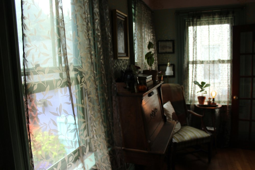 Hand-made curtains match hand-painted wall murals Photo by Jessica Jennings
