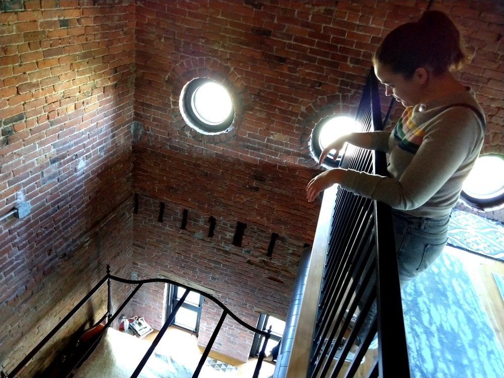 30 foot ceilings and a loft inside the steeple of this former Victorian church building Photo by Jessica Jennings
