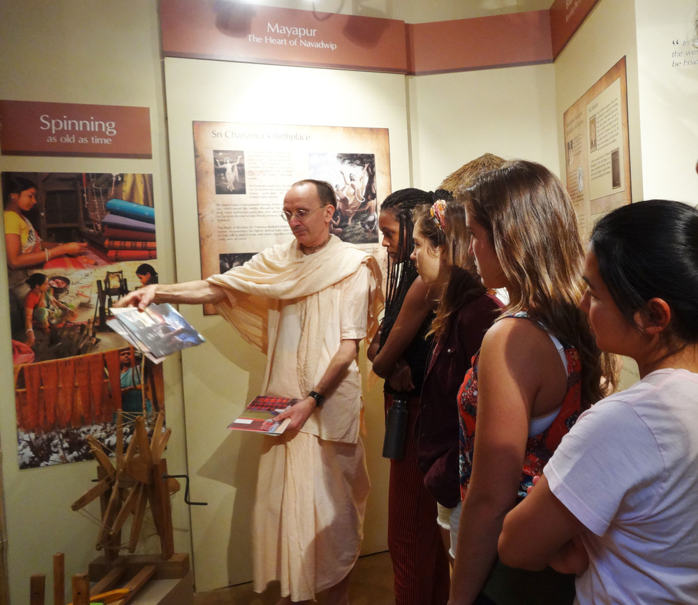 Shree (extreme left, Gallery Manager,  The Sacred India Gallery ) showing the students around the gallery
