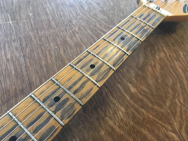 Heavy relic job on the fretboard of an 80's Ibanez Blazer.  Swipe to see before.  What say you? • • #relic #strat #ibanez #blazer #80s #guitartech #guitarrepair #luthier #customguitar #atx #austin #soco #southcongress
