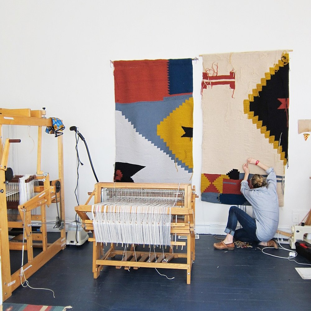 Me in the studio finishing the tapestries before install day.