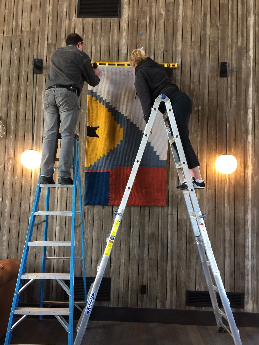 Art Handlers Leslie and Darrel installing the tapestries.