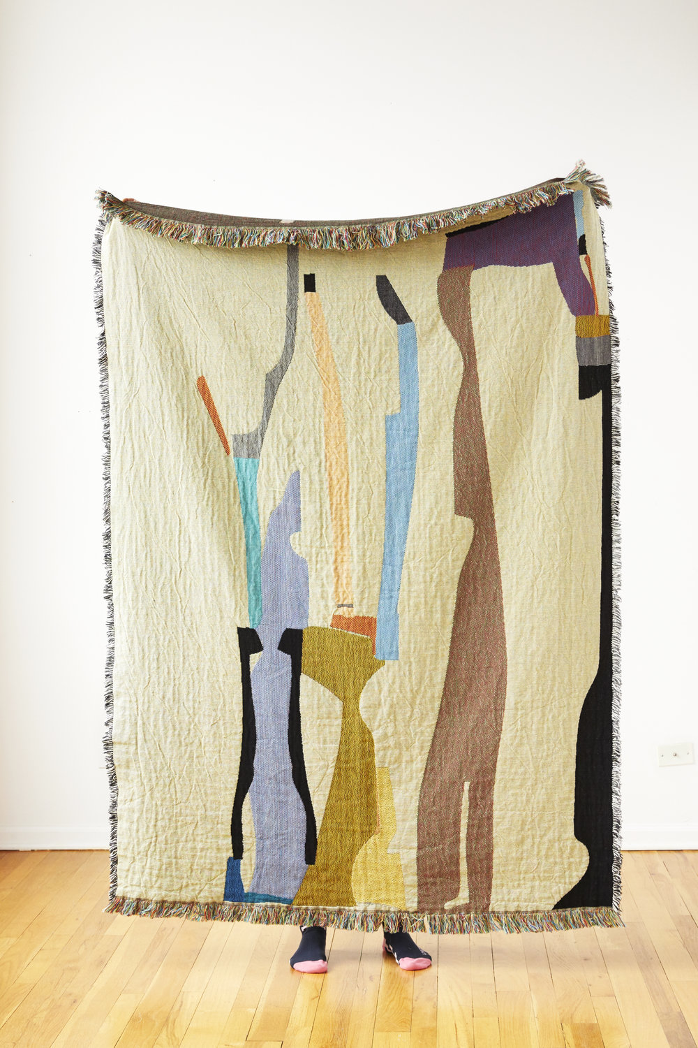 Puzzle   is a reversible cotton throw inspired by weavings of the Ait Bou Ichaouen women of the High Atlas Mountains. Their symbolic, colorful weavings tell the stories of their daily lives and are used as beds, blankets, walls in the tent, seats and rugs.