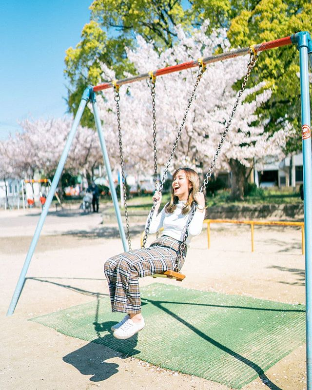Feeling like a kid all over again 🧸This was taken at a random playground in our neighborhood in Osaka! Pleasantly surprised by the number of sakura trees here and of course, we had to take some pictures. (Photo by @cookiesnqream) #travelwithbren