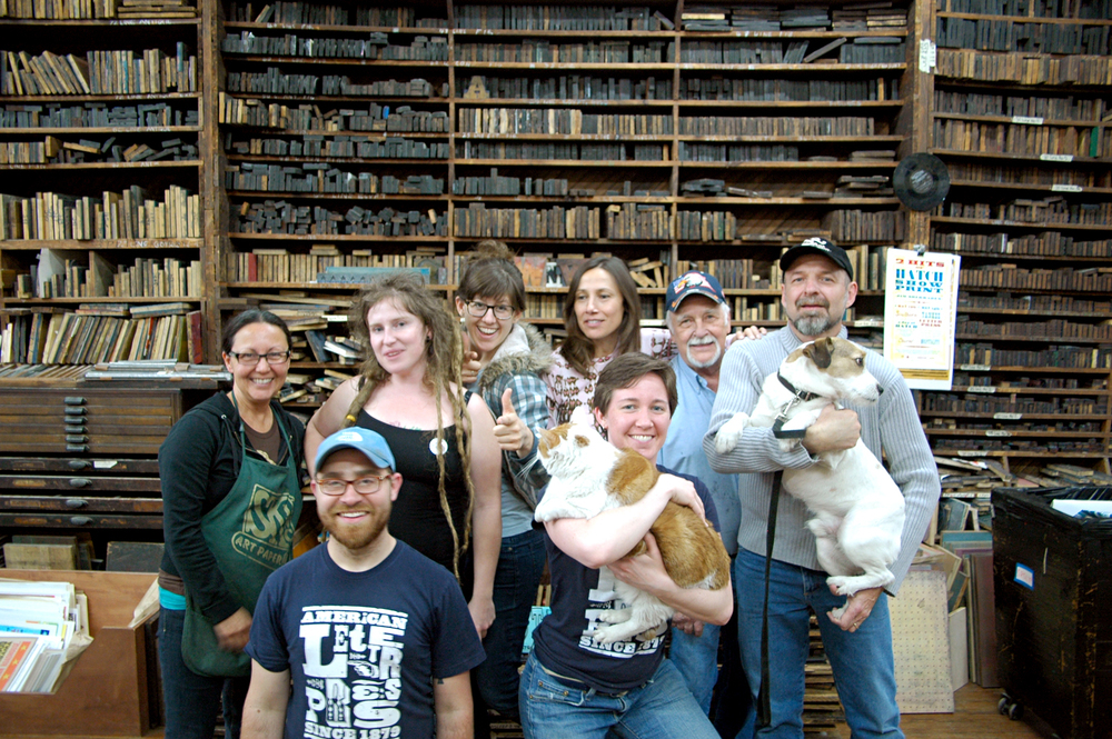 Our last staff photo before I left for Iowa in 2011. RIP, Huey the Hatch Cat.
